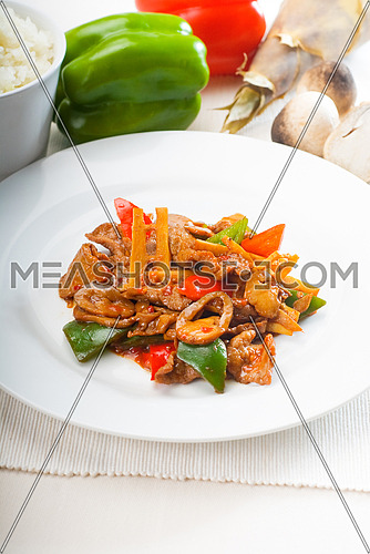 typical chinese dish,fresh beef stir fried with pepperrs bamboo sprout and mushrooms