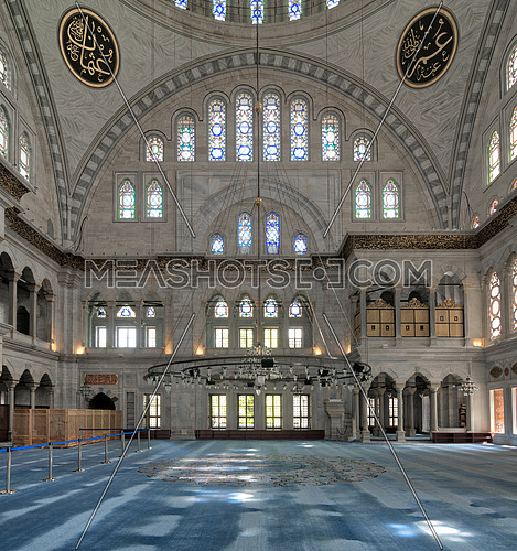 Interior of Nuruosmaniye Mosque, an Ottoman Baroque style mosque built in 1755, with a huge arches & many colored stained glass windows located in Shemberlitash, Fatih, Istanbul, Turkey