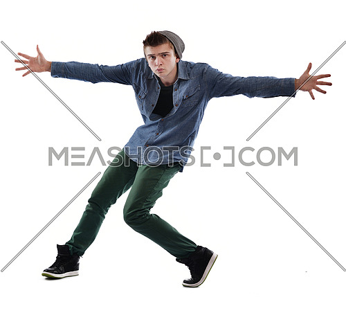 young boy man teen dancing and jumping isolated on white background in studio