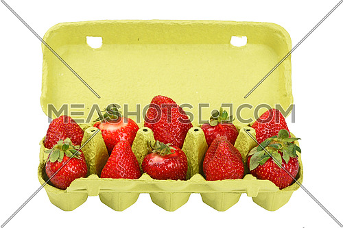 Red mellow strawberry in open green carton egg carrier container tray isolated on white background