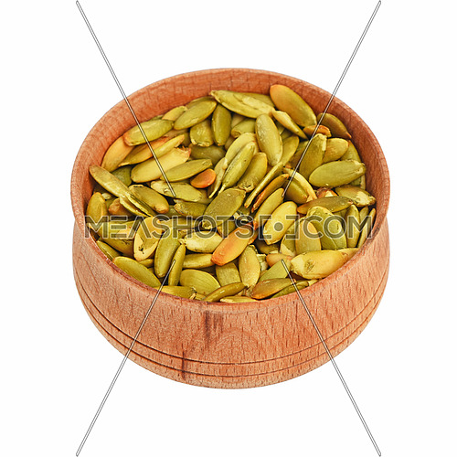 Roasted pumpkin seeds in wooden bowl high angle view isolated on white background