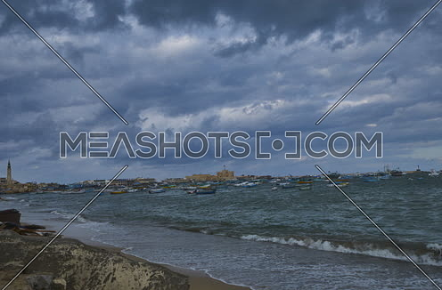 Fixed Shot for sea shore showing fishing boats and street at alexandria at day