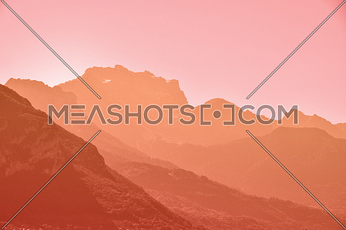 Sunset or sunrise aerial perspective mountain range landscape with clear sky copy space