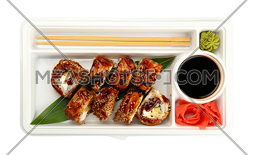 Close up take away set of six unagi sushi rolls with eel in disposable plastic tray isolated on white background, elevated top view, directly above