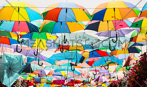 A ceiling of colorful umbrellas