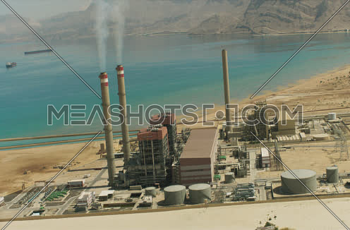 Arial shot 180 degree around a Factory at Suez at day
