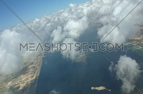 Arial shot for clouds and a city from above