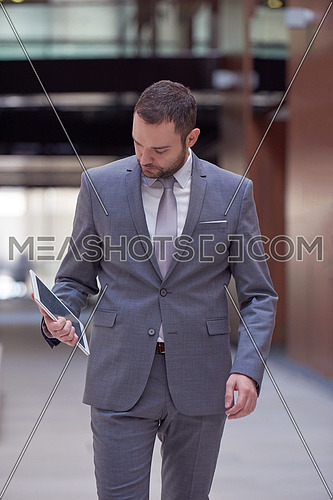 portrait of young business man with tablet computer at modern office
