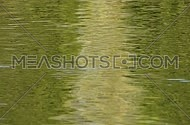 Running green ripples on water surface, moving flow background, Full HD 1080