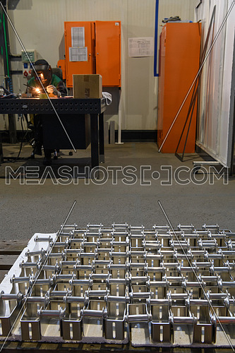 The first phase of metal and aluminum processing. Processed products from CNC machines stacked on a pallet in a large modern factory. High quality photo