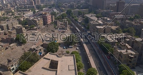Reveal Shot from Drone for Cairo while Metro is passing by at day
