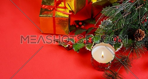 Christmas with gifts and holiday decorations on, red background