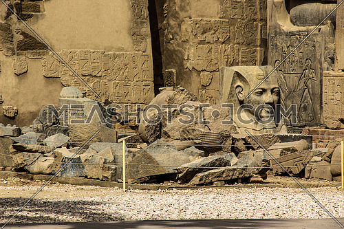 a photo at Luxor temple in Luxor city, Egypt showing broken parts of pharaonic statue