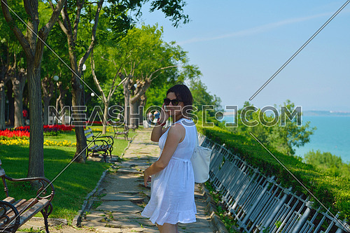 Pretty young business woman using mobile phone outdoor