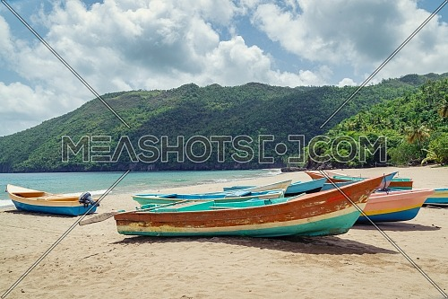 Old fisherman boats on the beach at the day,Samana beach,Dominican Republic.