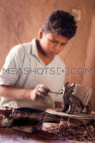 Young boy at pottery school in Tunis Village, Fayoum, Egypt