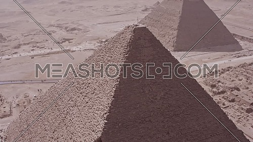 Reveal Shot Drone for The Great Pyramids of Kufu showing the pyramid of Khafre in background at day