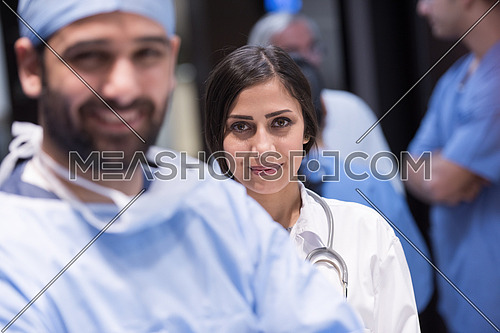 portrait of middle eastern team of doctors in a large modern clinic, two in front of the other
