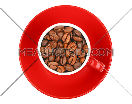 One small red espresso cup full of roasted coffee beans, with saucer isolated on white background, top view, bird eye view