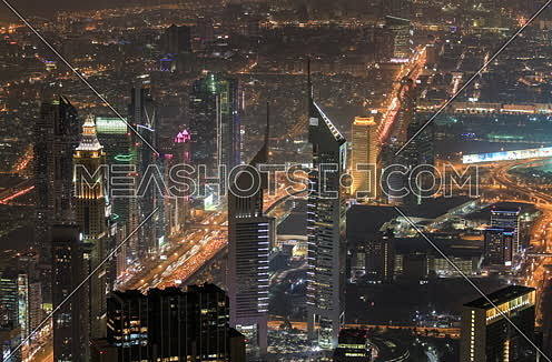Dubai Emirates towers by night timelapse
