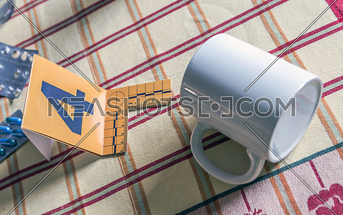 White Mug in crime scene. Test marked with number four, conceptual image