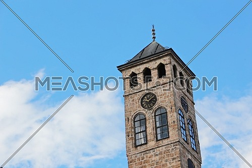 Low angel for Ottoman clock tower (sahat kula) detail in Sarajevo. Bosnia and Herzegovina at day.