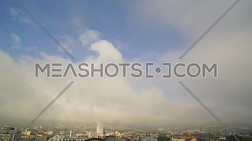 Swirling cloud time lapse over Cape Town with views of Table Mountain and Lions Head Mountain