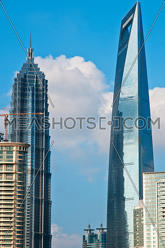 shanghai pudong view from puxi new bund on a sunny day with white clouds and blue sky