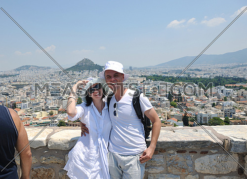 young couple portrait in love have romantic time on summer vacation holidays in greece santorini