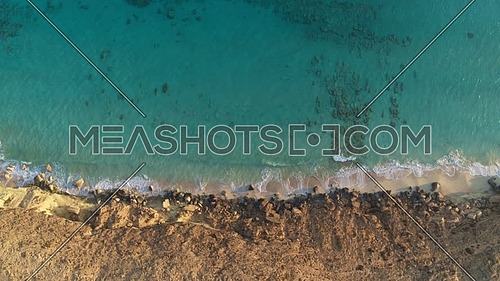 Top view shot for The Mediterranean Sea and a cliff by day in North Cost - Egypt.