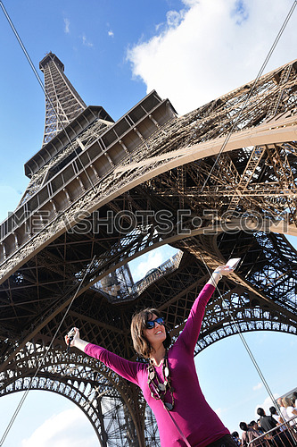 tourist people in france paris with eiffel tower in background