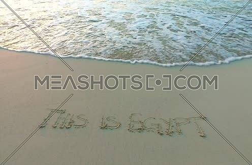 Track Shot for (This is egypt) written on the sand at sunset