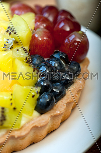 fresh homemade fruits cake pie over wood cutting board