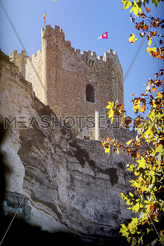 Alcala del Jucar, Spain - October 29, 2016: Side view of the village, on top of limestone mountain is situated Castle of the 12TH century Almohad origin, Alcala del Jucar, Albacete province, Spain