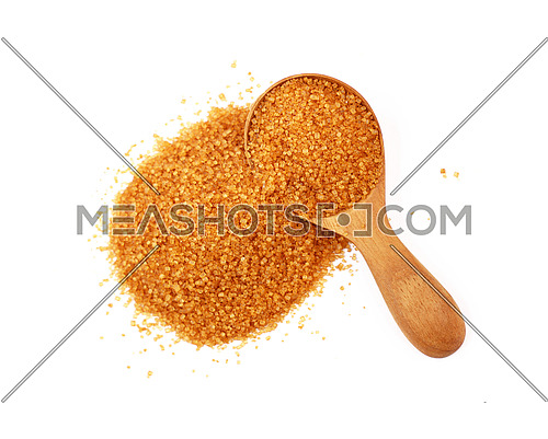 Wooden scoop spoon of brown cane sugar with pinch of sugar spilled around isolated on white background, top view