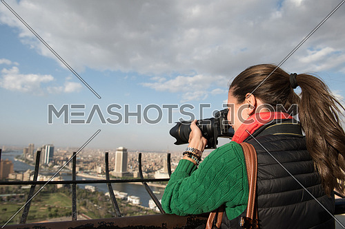 female tourist taking photos from cairo tower at beautiful sunny day