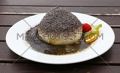 Parena buchta, steamed sweet dumpling bun topped with poppy seeds, sugar and butter, traditional in Slovakia, Hungary and Austria, close up, high angle view