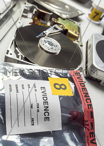 Police expert examines hard drive in search of evidence, conceptual image