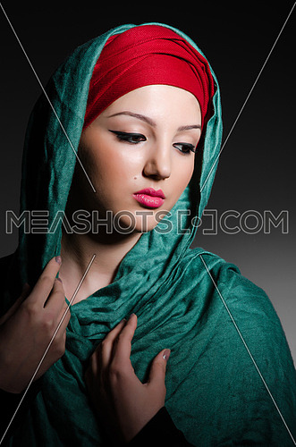 Portrait of the young woman with headscarf
