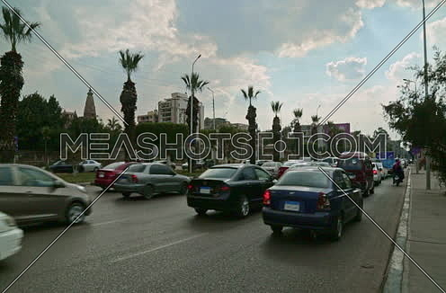 Fixed Shot for traffic at Salah Salim Street showing Le Baron Palace in background at Daytime