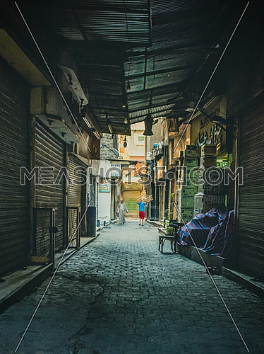 an alley in a poor district in egypt El darb El Ahmar