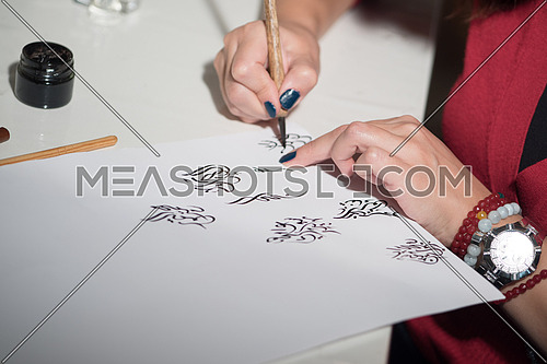 Arabic Calligraphy writing with Ink and Wooden Pen