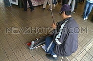 A man playing an instrument in the street