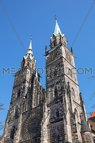 Saint Lawrence cathedral (St. Lorenz) over clear blue sky, medieval gothic church in Nuremberg, Germany, low angle view