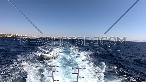 Long shot for backside boat showing Sharm El Shaikh City and Inflatable boat