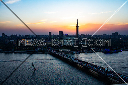 A panoramic view of cairo river nile, qasr el nile bridge and the cairo tower at sunset