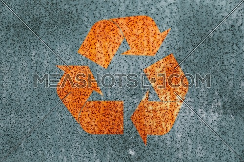 Rust stained corroded metal surface with grunge recycling logo icon