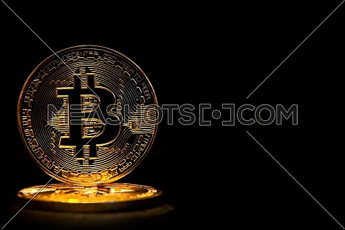 Bitcoin isolated on black background.
