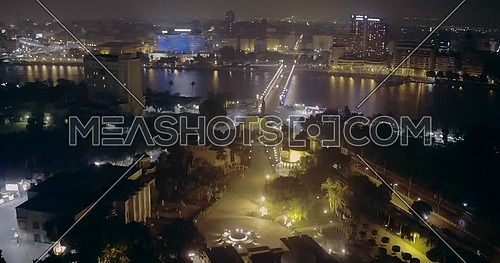 Aerial shot flying around Cairo opera house showing the river Nile and Kasr AL Nile Bridge at night