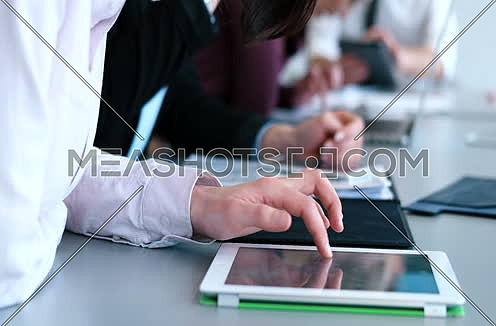 close up of hands using tablet during conference